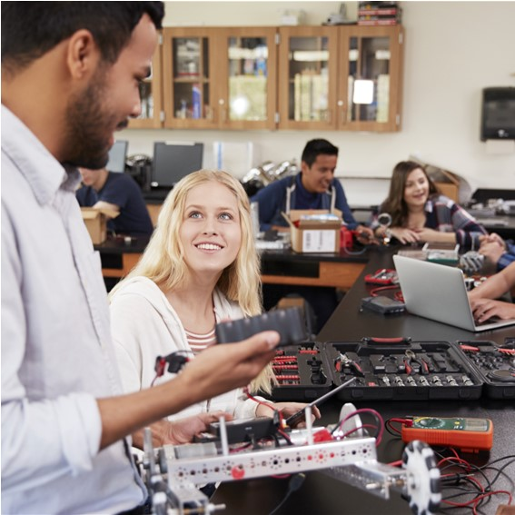 Robotic teacher showing how to use electricity to a student