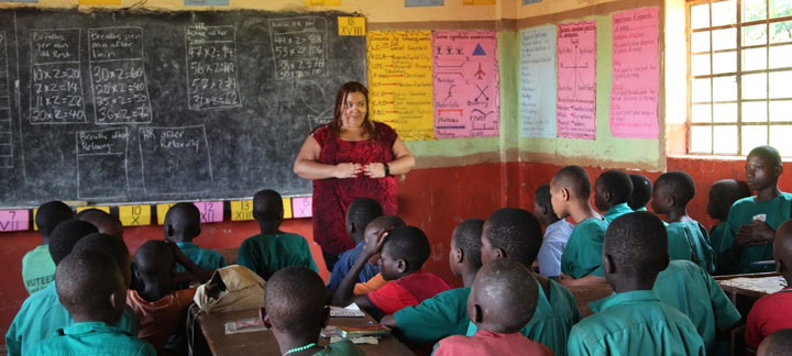 Alicia Luna teaches a lesson at St. Anne Ggoli Primary School in Kamengo.