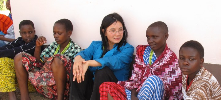 Hong Te, Faculty of Education graduate, with Tanzanian students.